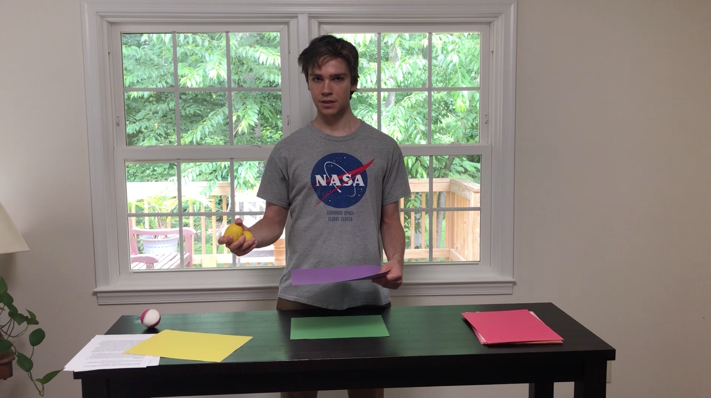 Gavin Courtright explaining 2D materials using paper and lemons as props